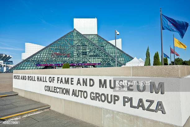 rock and roll hall of fame sign, museum and flags - rock and roll hall of fame cleveland stock photos and pictures
