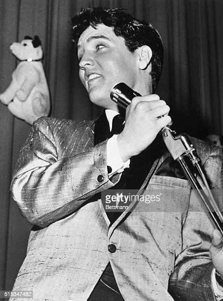 Rock and roll king Elvis Presley gives out here this afternoon during his part in giant charity show sponsored by the king himself Elvis hoped to...