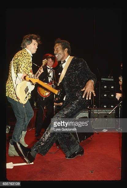 Rock and roll legend Chuck Berry dances while Keith Richards of the Rolling Stones plays guitar Guitarist John Fogerty of Credence Clearwater Revival...