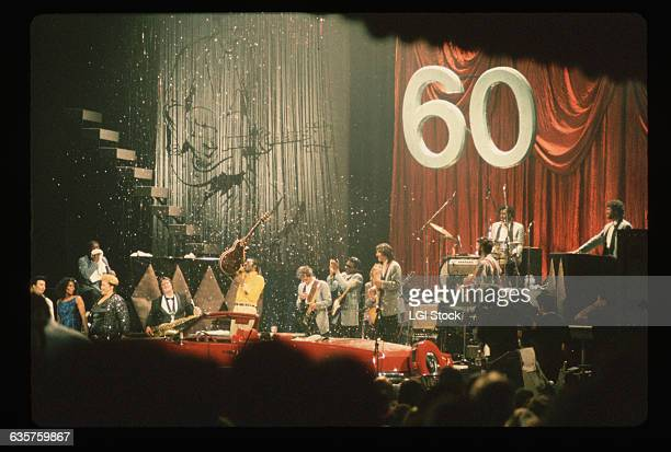 Rock and roll legend Chuck Berry receives a red convertible at his 60th Birthday Concert Among the performers on stage with Berry are Etta James and...