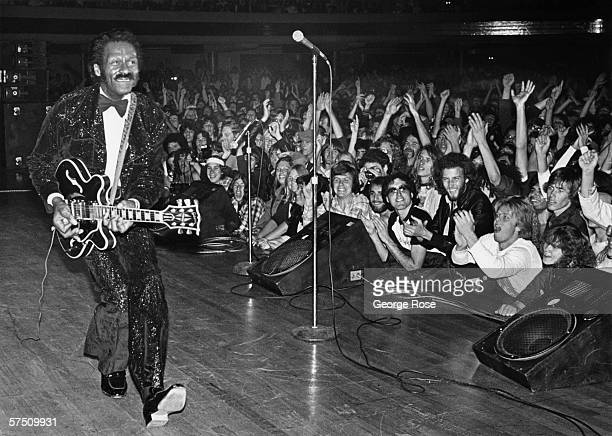 Rock and roll legend Chuck Berry struts his signature duck walk while playing his Gibson guitar to the delight of fans during a 1980 Hollywood...