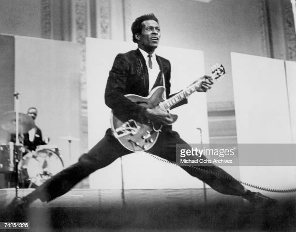 Rock and roll musician Chuck Berry does the splits as he plays his Gibson hollowbody electric guitar in circa 1968