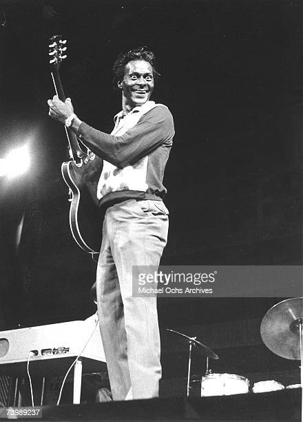 Rock and roll musician Chuck Berry performs onstage with his Gibson hollowbody electric guitar in circa 1975