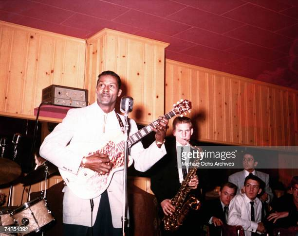 Rock and roll musician Chuck Berry plays electric guitar as he performs with his band in circa 1956