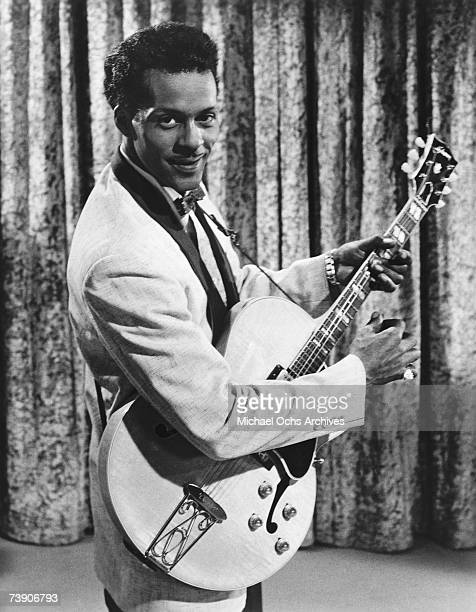 Rock and roll musician Chuck Berry poses for a portrait holding a Gibson hollowbody electric guitar in a scene from the movie 'Go Johnny Go' which...