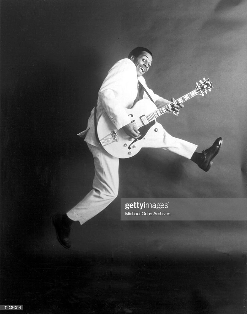 Rock and roll musician Chuck Berry poses for a portrait holding his Gibson hollowbody electric guitar in circa 1958.