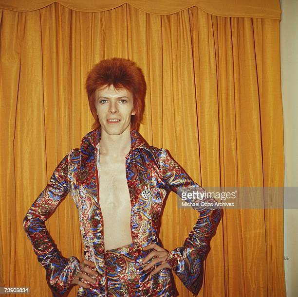 Rock and roll musician David Bowie poses for a portrait dressed as 'Ziggy Stardust' in a hotel room in 1973 in New York City New York