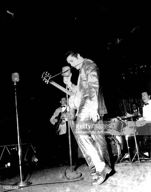 Rock and roll musician Elvis Presley performs on stage in his $2500 goldleaf suit designed by Nudie Cohen He only wore the full suit twice On March...