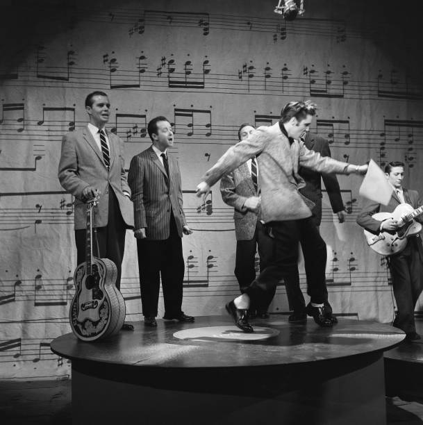 Rock and roll musician Elvis Presley performs