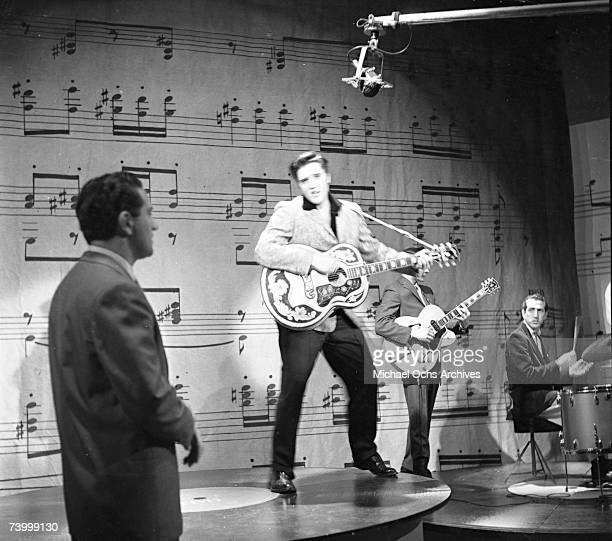 Rock and roll musician Elvis Presley performs on stage on the Ed Sullivan Show in New York City, NY on January 6, 1957.