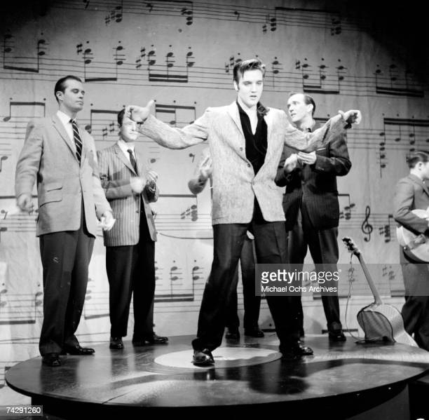 Rock and roll musician Elvis Presley performs on stage on the Ed Sullivan Show on January 6, 1957 in New York City, NY.