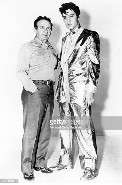 Rock and roll musician Elvis Presley poses with clothes designer Nudie Cohn in his $2500 gold lame suit He only wore the full suit twice on stage On...