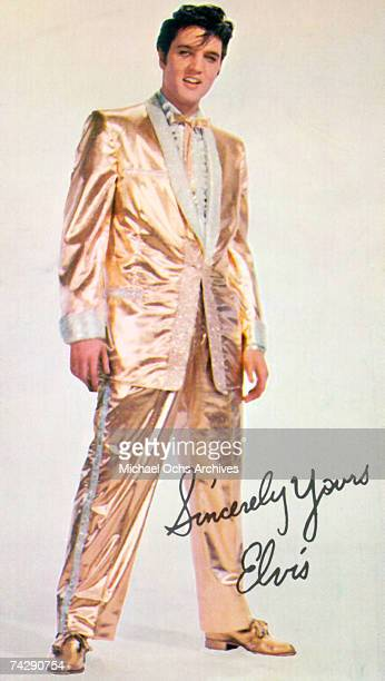 Rock and roll musician Elvis Presley poses with clothes designer Nudie Cohen in his $2500 goldleaf suit He only wore the full suit twice on stage On...