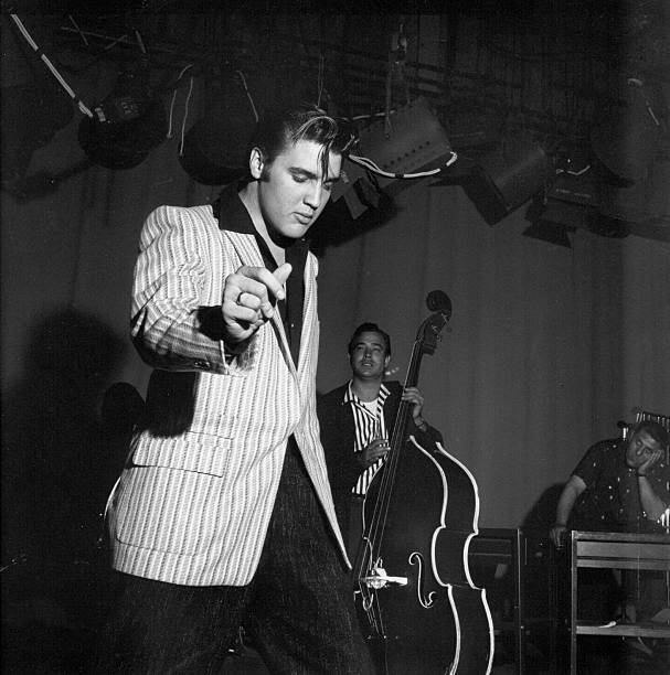 Rock and roll musician Elvis Presley rehearsing for his performance on the Milton Berle Show