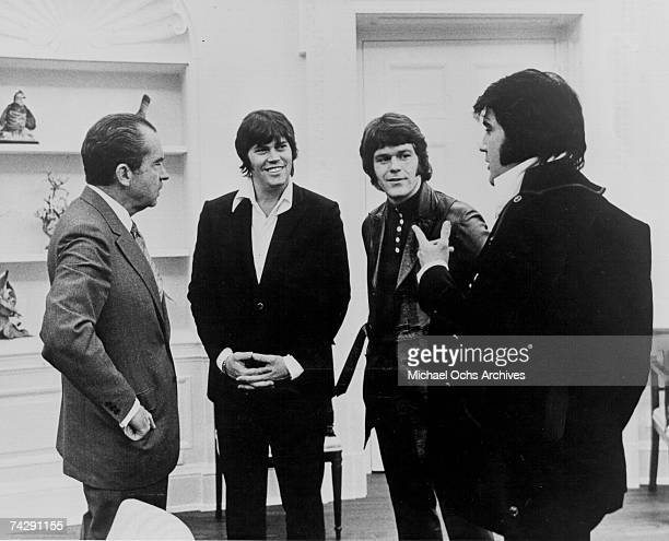 Rock and roll musician Elvis Presley visits President Richard Nixon on December 21 1970 at the White House in Washington DC Sonny West and Jerry...