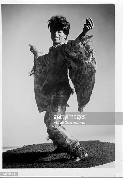 Rock and roll musician Little Richard poses for a portrait wearing a flamboyant outfit while standing on a shag carpet in circa 1975.