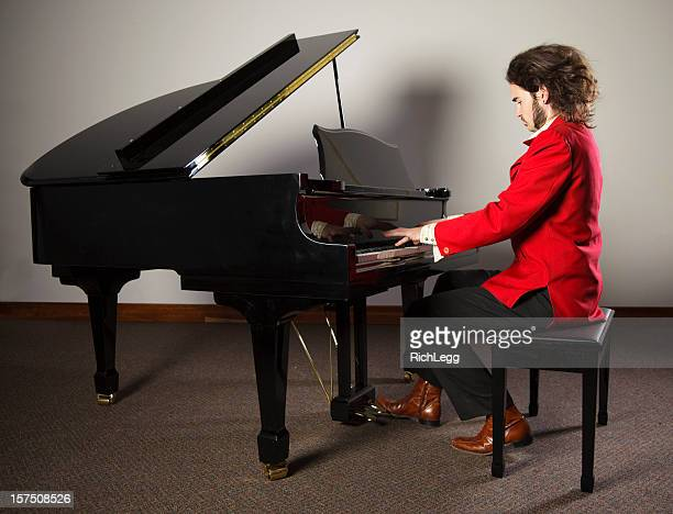 rock and roll piano player - grand piano stock photos and pictures