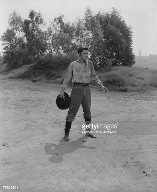 Rock and roll singer and actor Elvis Presley on the set of his film 'Love Me Tender' in August 1956 at the 20th Century Fox Ranch Malibu Creek State...