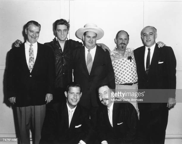 LOS Rock and roll singer and actor Elvis Presley with RCA executives in August of 1956 in Los Angeles California At the far left stands RCA Records...