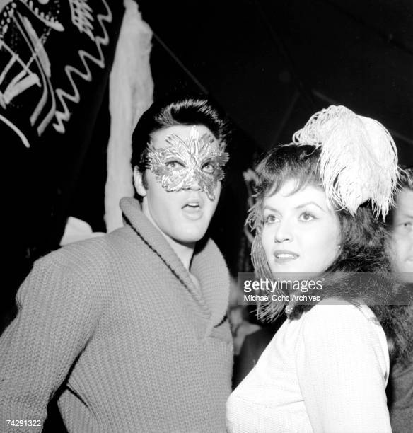 Rock and roll singer Elvis Presley and actress Joan Bradshaw wear costumes to celebrate Halloween on October 31 1957 in Hollywood California
