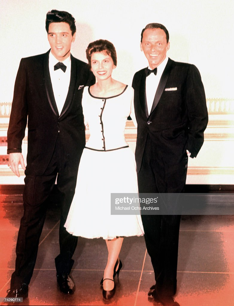 Elvis Presley with Frank Sinatra and a woman : News Photo