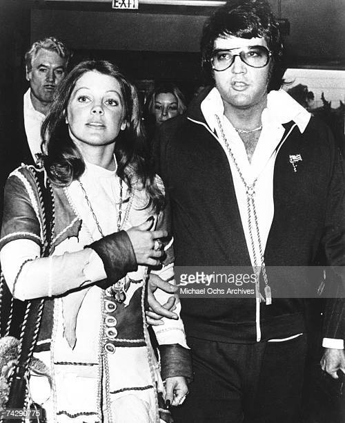 Rock and roll singer Elvis Presley and his wife Priscilla Beaulieu Presley leave the courthouse hand in hand following a short divorce hearing on...