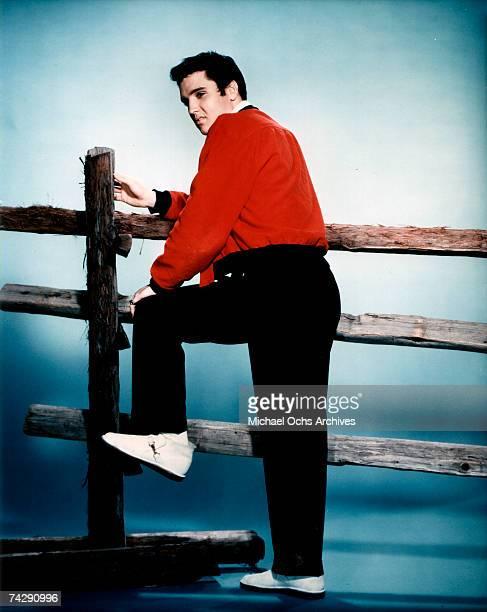 Rock and roll singer Elvis Presley as he appears in the film 'Jailhouse Rock'
