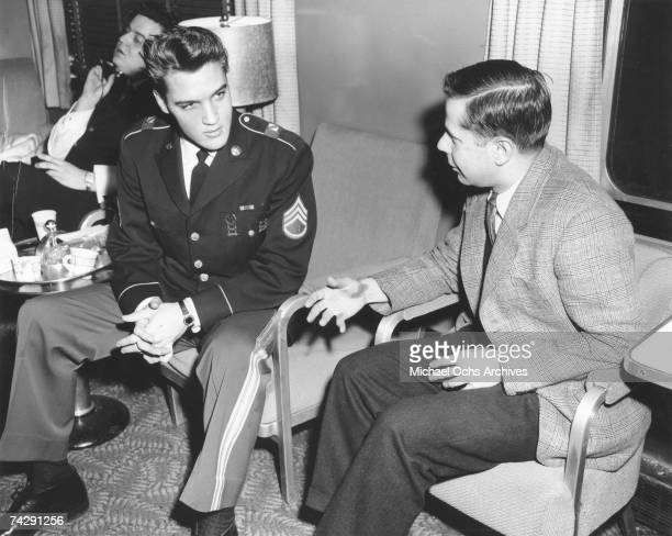 Rock and roll singer Elvis Presley gets interviewed while sporting his US Army uniform in 1959 in Germany.