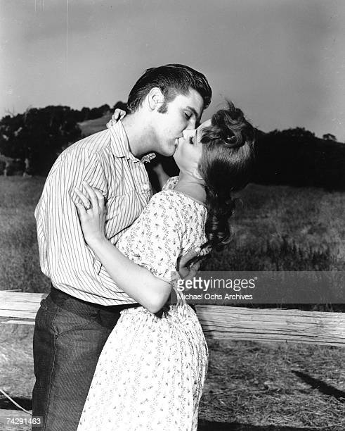 Rock and roll singer Elvis Presley kisses Debra Paget in a still from 'Love Me Tender' in Los Angeles in 1956