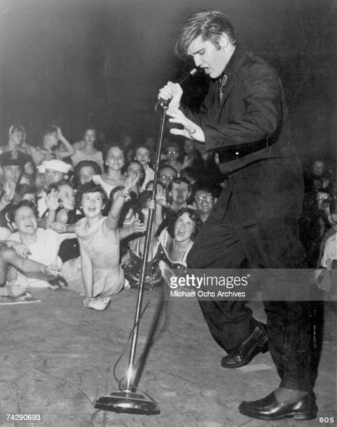 Rock and roll singer Elvis Presley performs on stage at Russwood Park on July 4 1956 in Memphis Tennessee