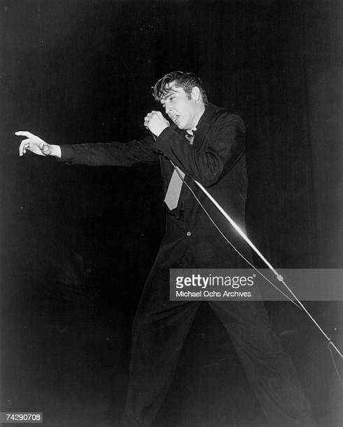 Rock and roll singer Elvis Presley performs on stage in 1956