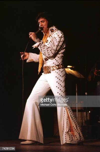 Rock and roll singer Elvis Presley performs on stage in 1974