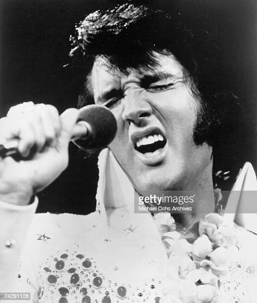 Rock and roll singer Elvis Presley performs onstage at the International Convention Center in Honolulu Hawaii on January 14 1973