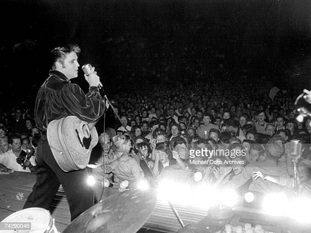 Rock and roll singer Elvis Presley performs outside to adoring fans on September 26 1956 in his hometown of Tupelo Mississippi