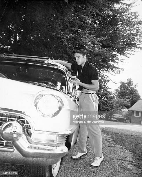 Rock and roll singer Elvis Presley polishing his 1956 Lincoln Continental in 1956 in Memphis Tennessee Photo by Michael Ochs Archives/Getty Images
