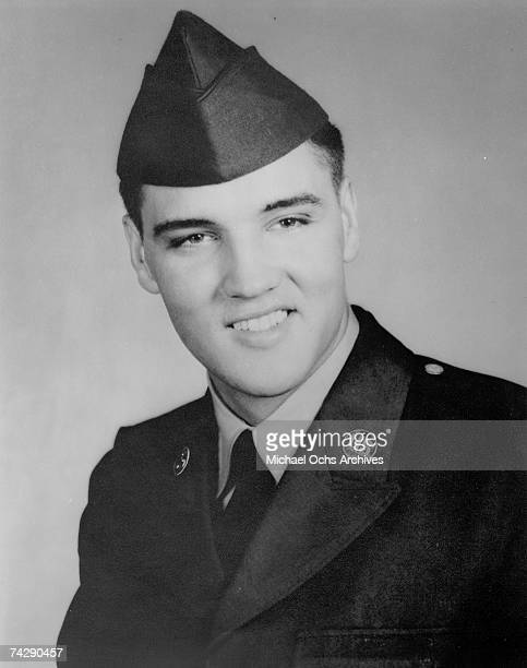 Rock and roll singer Elvis Presley poses for a portrait during his tour of duty in Germany in 1958.