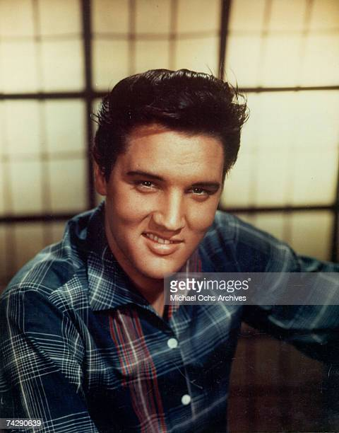 Rock and roll singer Elvis Presley poses for a portrait in circa 1964