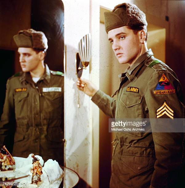 Rock and roll singer Elvis Presley poses for a portrait next to a mirror during his tour of duty in Germany in February of 1959.