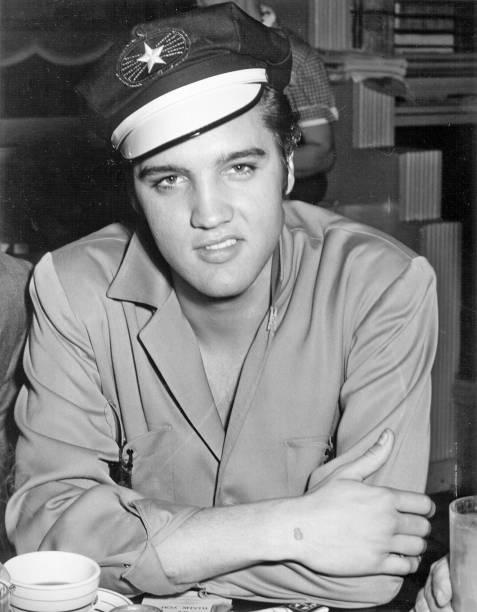 Elvis Presley wearing motorcycle hat