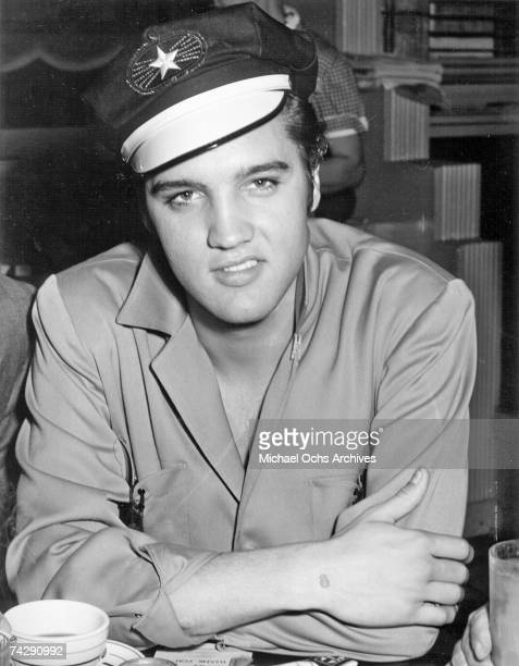 Rock and roll singer Elvis Presley poses for a portrait wearing motorcycle hat in June of 1956 in Hollywood California