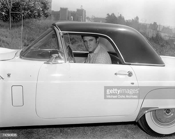 Rock and roll singer Elvis Presley poses for a portrait while sitting in his car in 1956 Photo by Michael Ochs Archives/Getty Images