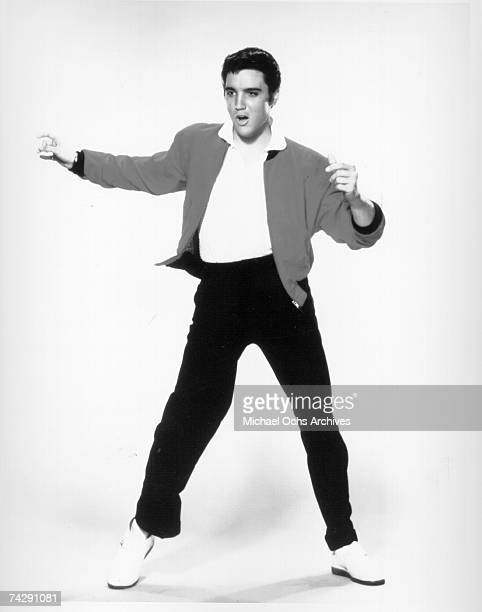 Rock and roll singer Elvis Presley poses for a studio portrait in 1957