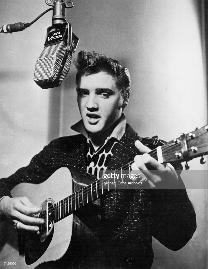 Rock and roll singer Elvis Presley recording in an RCA Victor studio in 1956.
