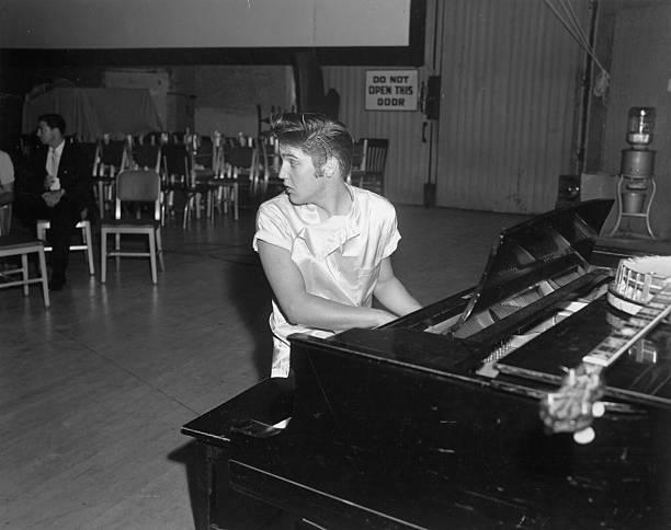"Elvis Presley records ""Love Me Tender"" at a piano"