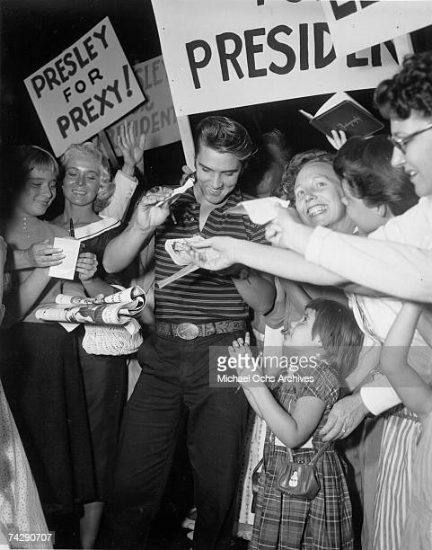 Rock and roll singer Elvis Presley signs autographs on August 16 1956 in Los Angeles California