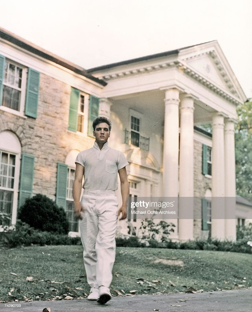 Rock and roll singer Elvis Presley strolls the grounds of his Graceland estate in circa 1957.