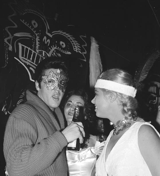 Elvis Presley and Jeanne Carmen at a Halloween party