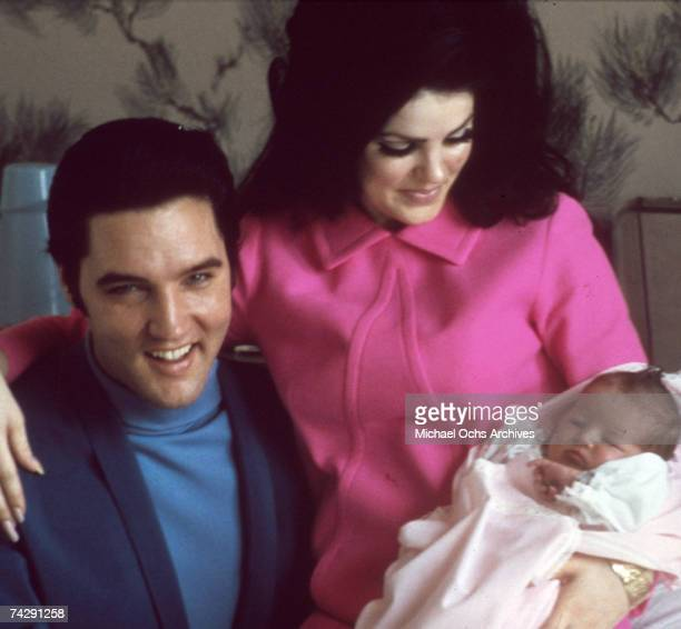 Rock and roll singer Elvis Presley with his wife Priscilla Beaulieu Presley and their 4 day old daughter Lisa Marie Presley on February 5, 1968 in...