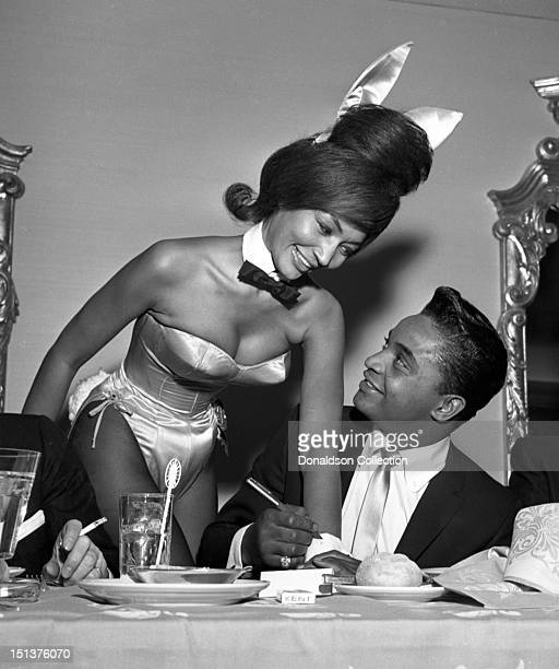Rock and roll singer Jackie Wilson autographs the cuff of a Playboy Bunny at a dinner for the Motion Picture Pioneers Association at the Playboy Club...