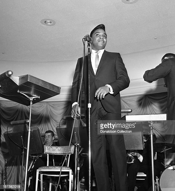 Rock and roll singer Jackie Wilson performs onstage at a dinner for the Motion Picture Pioneers Association at the Playboy Club on November 19 1962...